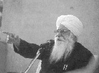 Sant Ji designating a dear one to sing a bhajan